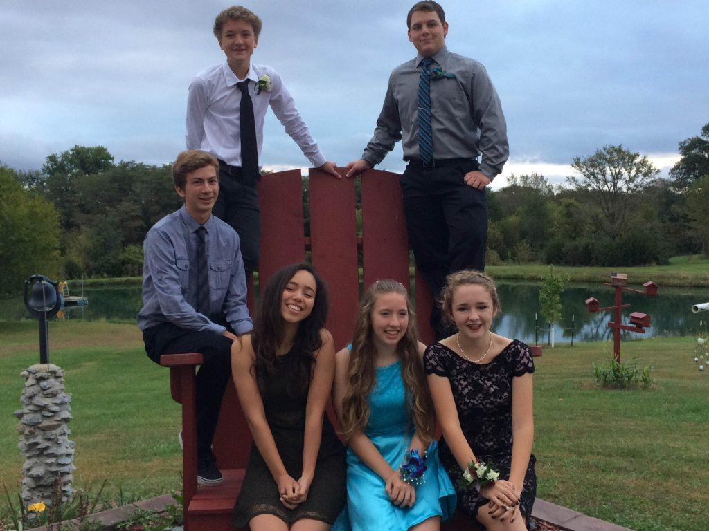 Fynn Utermark's group takes pictures before the homecoming dance.