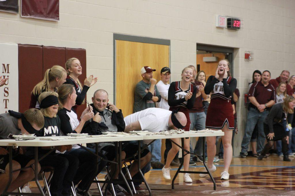 Maggie Willems, Sue Deibner, and Matt Haddy laugh alongside Preston Petersen and Matt Browning who think they're involved in a pie eating contest. Photo by: Summer Everhart