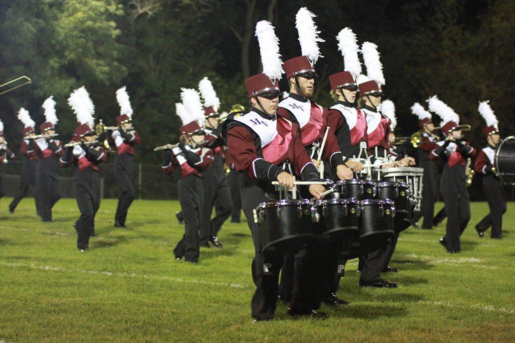 The drumline performs at halftime. Photo by Emma Klinkhammer.