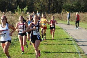 Shae Banwart and Quinnie Rodman run at the district meet Oct. 20.