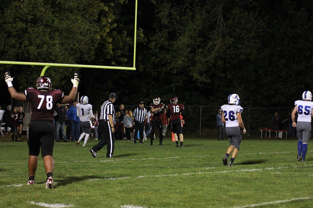 Tristan Wirfs celebrates as Cale Snedden makes a TD, one of three he made in the homecoming game. Photo by Emma Klinkhammer