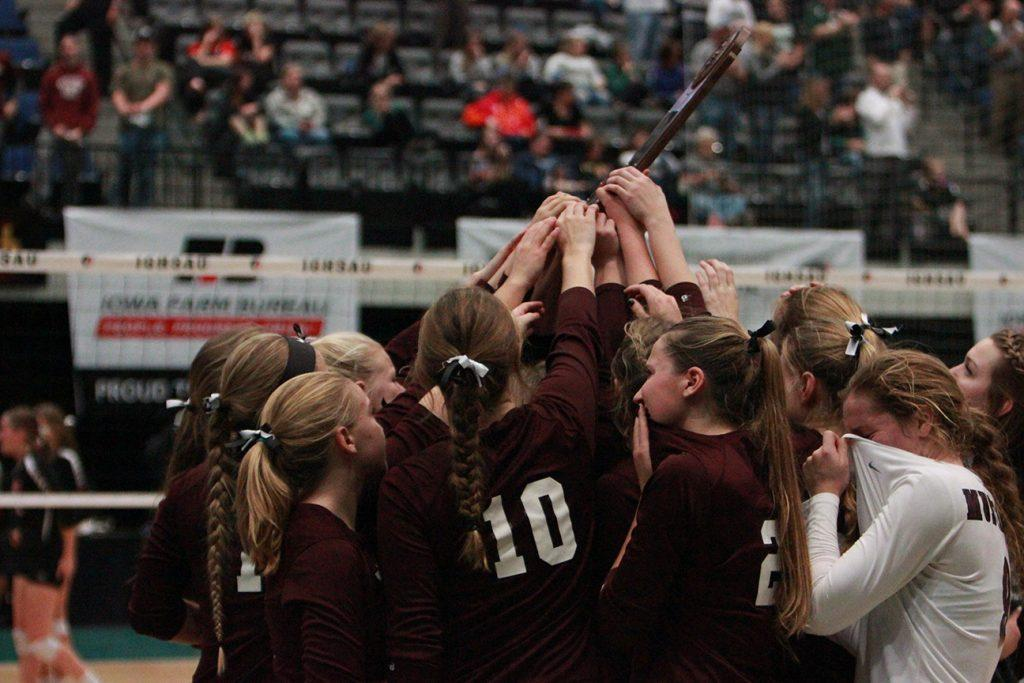 The team gathers around their trophy after losing to Union in  four sets.