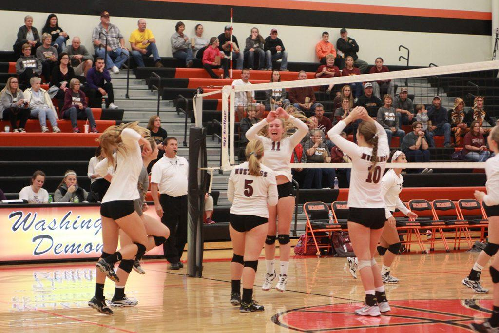 Wynne Vandersall celebrates a point with her team. Vandersall scored 10 kills and an ace in the game.