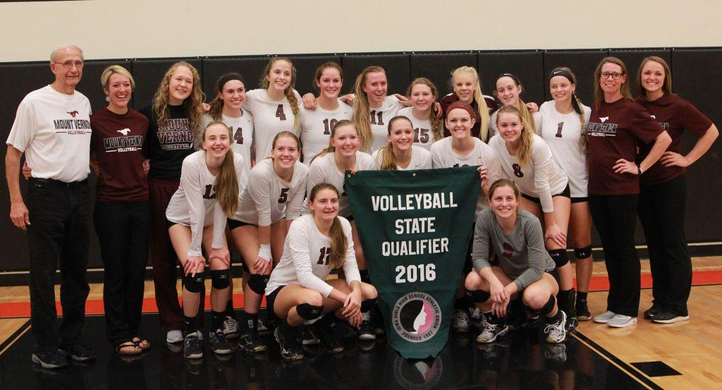 The team poses with the state qualifier banner. They next play Sioux Center on Nov. 9.