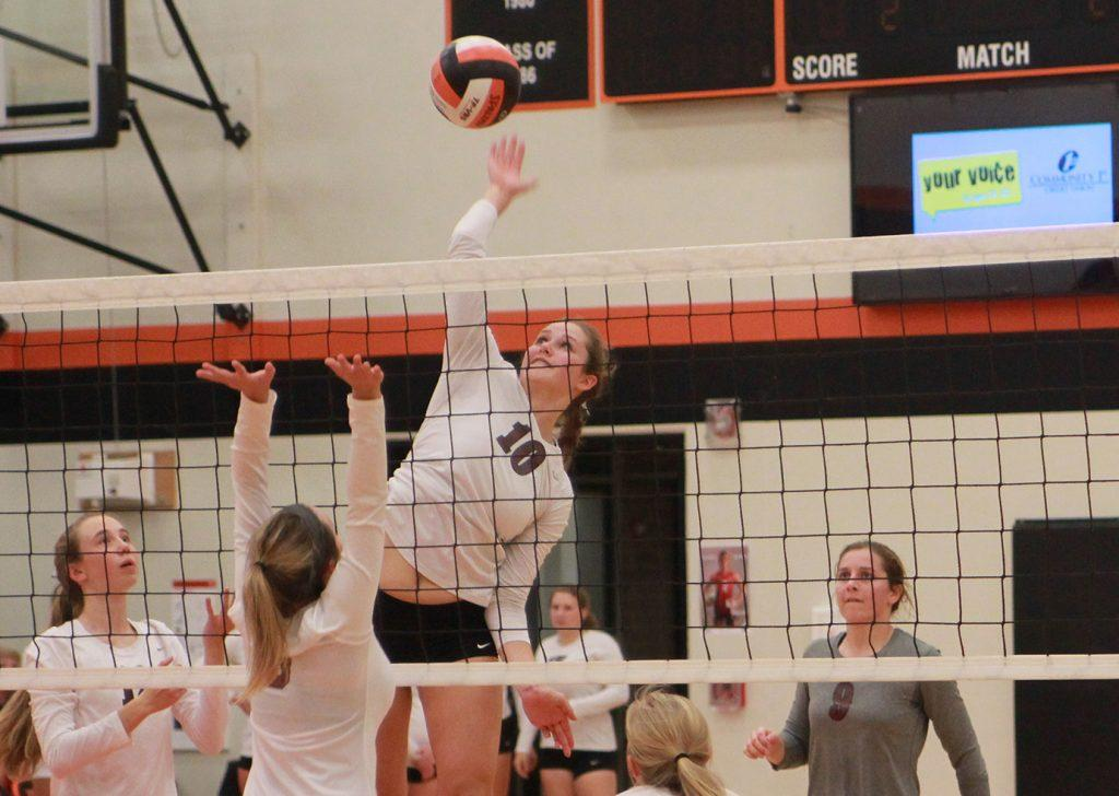 Katie Wycoff spikes the ball against Davis County on Monday. The Mustangs won in three sets.