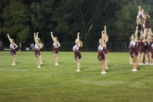 Cheerleaders perform at halftime on Aug. 31.  Photo by Gretchen Oelrich.