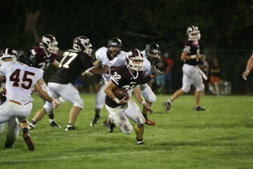 Trey Ryan runs the ball for Mount Vernon in the second quarter against Solon Aug. 30.  Trey made 13 tackles for the Mustangs, 11 of them solo.