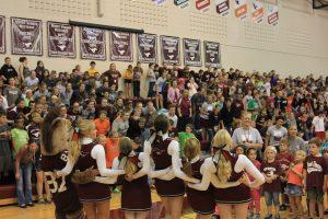Cheerleaders pump up the crowd Oct. 4.
