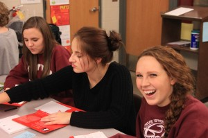 Science Olympiad members junior Haley Smith, and sophomores Jennifer Deininger and Emma Bradbury enjoy a game of Scattergories using science terms at a teambuilding night in November. Photo by Wyatt Swartzendruber.