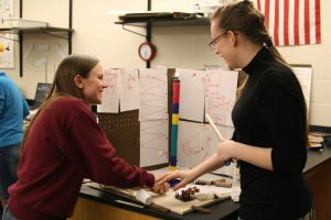 Junior Haley Smith gets help on her Mission Possible event from coach Alaina Appley. Photo by Renny Klein.