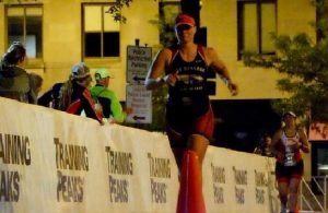 Gym teacher Chelsee Shortt finishes the Ironman in Wisconsin in September. The Ironman is a triathlon where athletes complete 2.4 miles of swimming, 112 miles of biking and 26.2 miles of running.