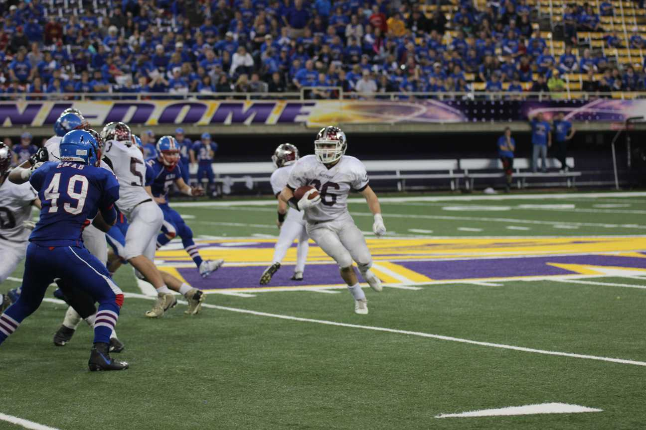 Sam Moore runs on the turf at the UNI Dome on Nov. 14.