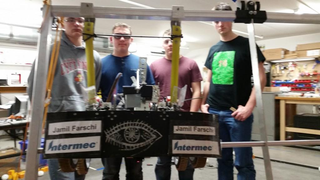 Team 458 shows off their robot hang in the lab.