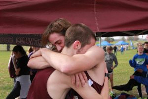 Jack Young and Zach Krogmann hug after the race, waiting to hear the results. Photo by Ben McGuire.