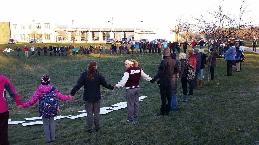 Community members gather peacefully before school Nov. 21 in a show of unity. Photo by Steve Brand.