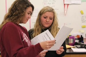 Juniors Laurel Sherman and Kate Liberko review their test from the Boyceville competition. Photo by Lauren Hauser.