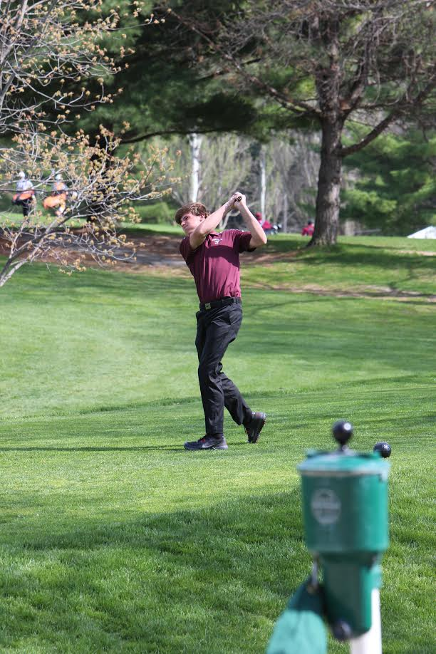 Drew Wolfe follows throu on his tee shot on the first hole at Kernoustie golf course. The Mustangs won the meet and Wolfe shot a 39. April 24. Photo by Paige Zaruba