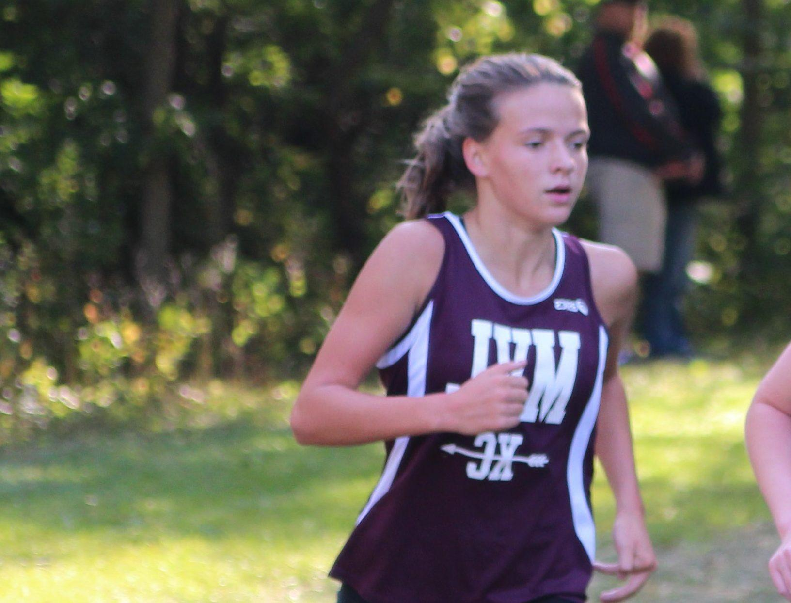 Aubrey Frey qualified for the state meet as an individual. She is pictured running in September. Photo by Ben McGuire.
