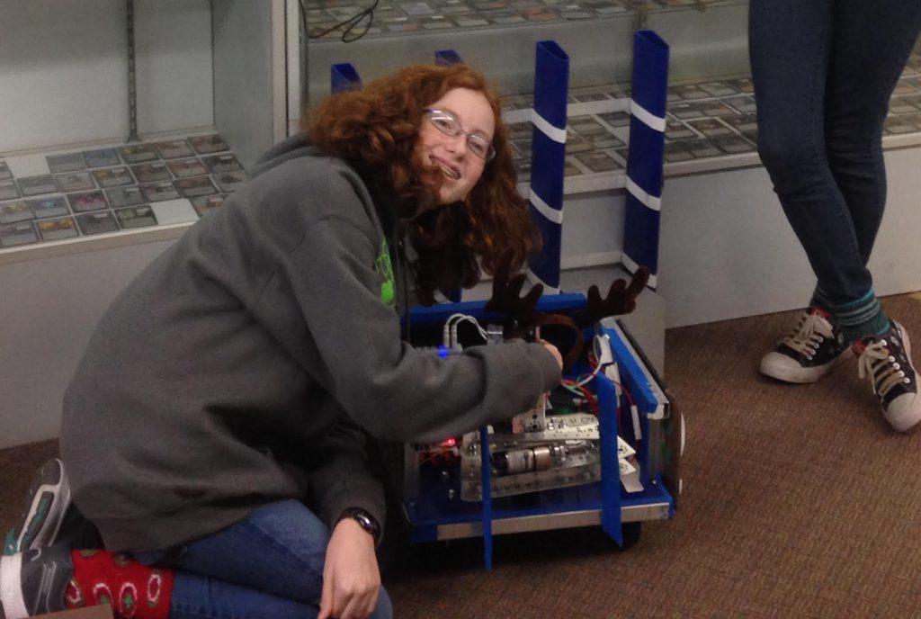 A robotics team shows off their robot at Magical Night Nov. 30.