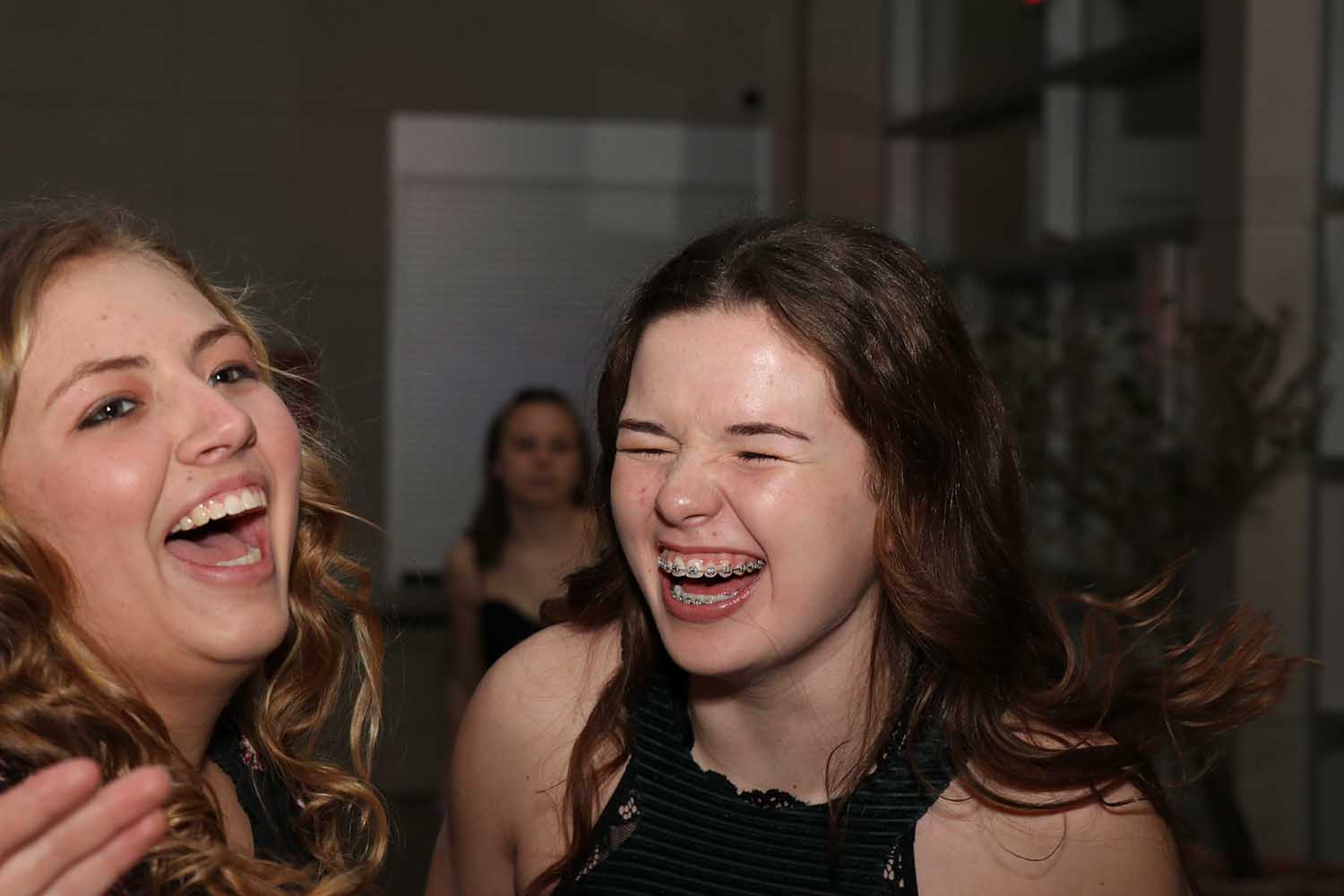 Sharing a laugh at the winter formal are Junior Kenzie Ketchum and sophomore Paige Beck.