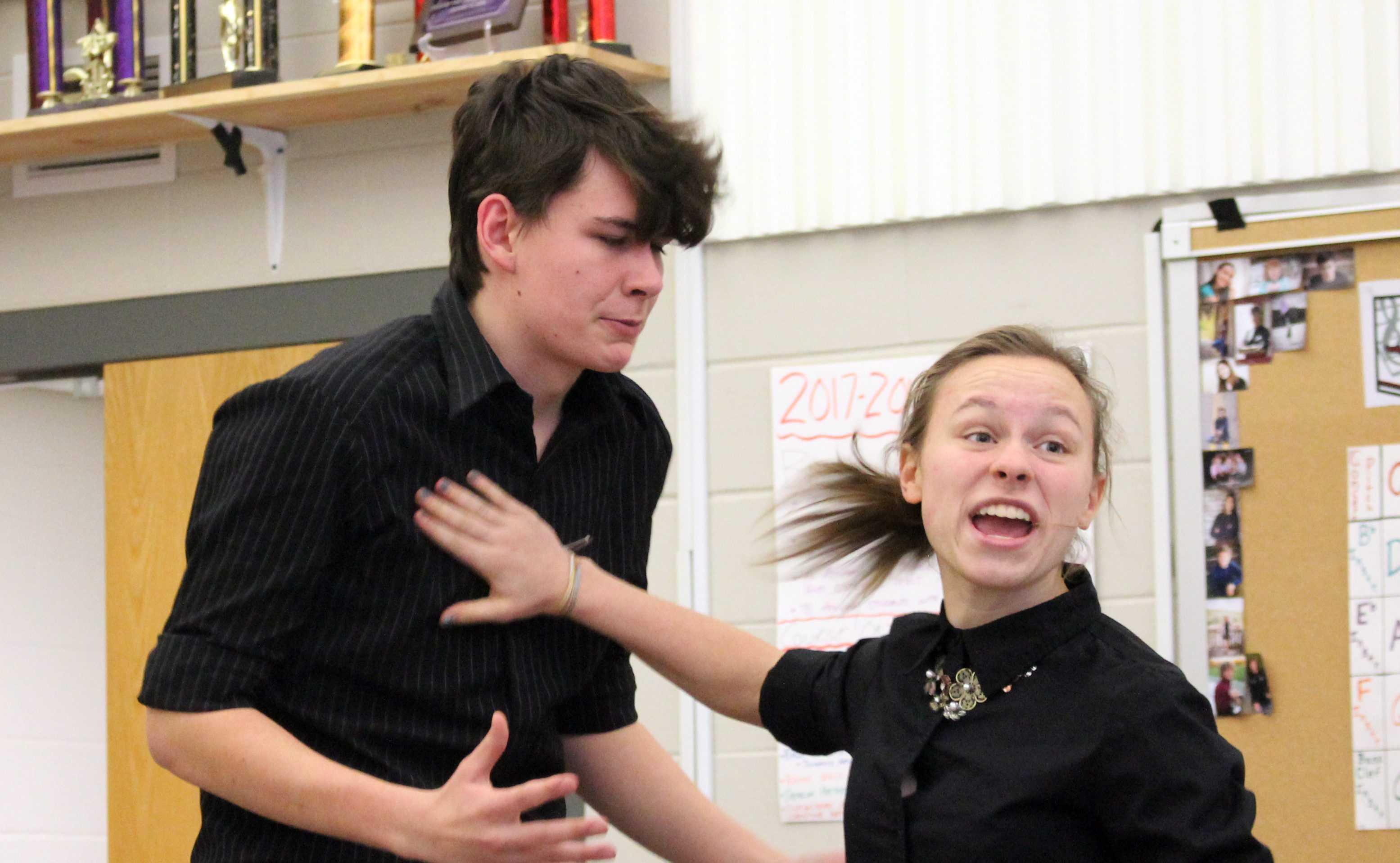 Senior Martin Benesh and junior Quinnie Rodman rehearse a scene.