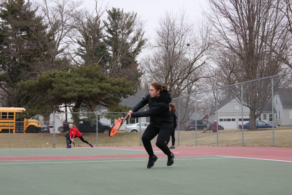 Sophomore Megan Zobac serves the ball back at the tennis meet at Cornell on May 8th.