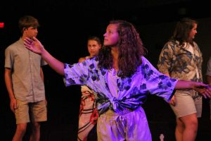 Senior Alina Merlak dances to a song during Dress Rehearsal for Once on This Island. Photo by Maddie Naeve.