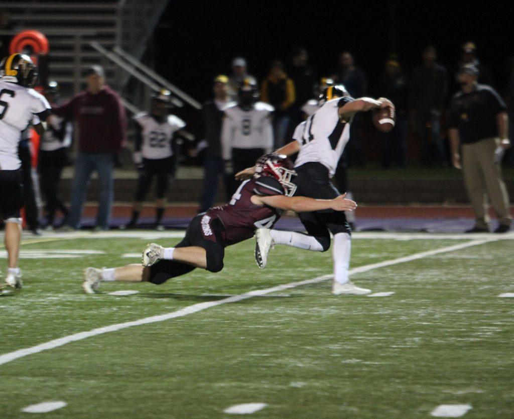 Nick Casey, senior, lunges toward the quarterback as he sacks him on Oct. 19.