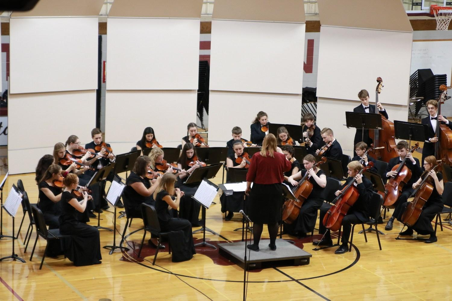 Director Tabitha Rasmussen and the High School Orchestra