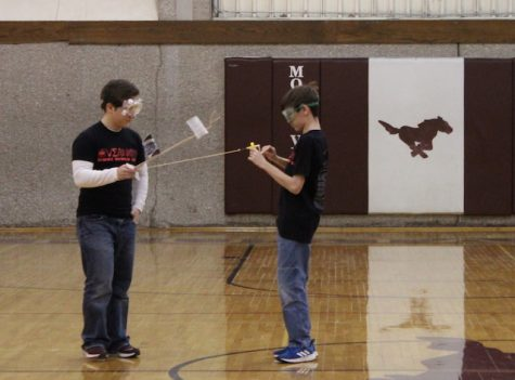 Freshmen Mark Liberko and Ben Johnson compete in the Science Olympiad Competition in the Middle School on Saturday Feb. 24
