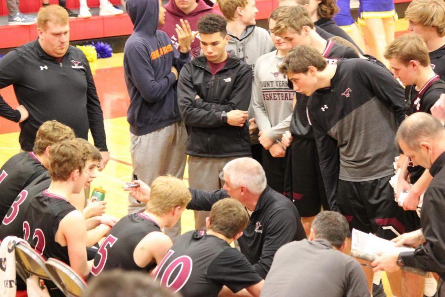 Coach Ed Timm talks to his team.