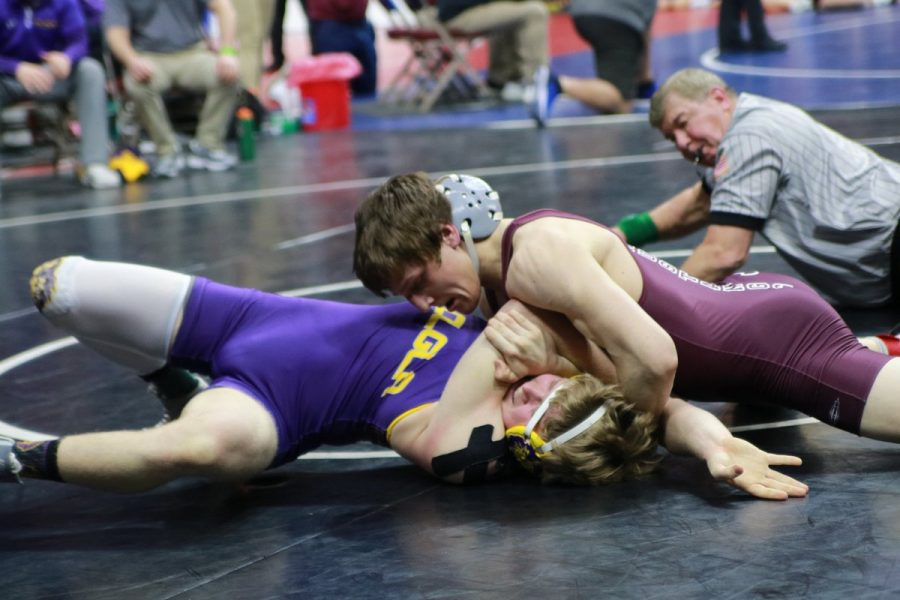 Undefeated senior Paul Ryan (170) won by fall over Bryce Vande Weerd   of Central Lyon/George-Little Rock High School in State 2A wrestling round one Thursday. Photo by Aydan Holub-Schultz.