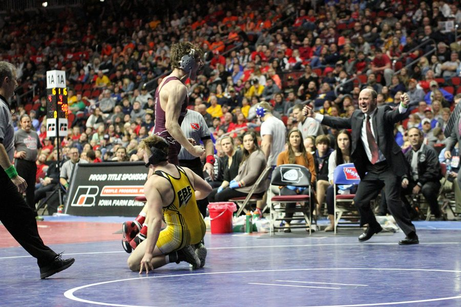 Senior Paul Ryan celebrates after completing his state finals match.
