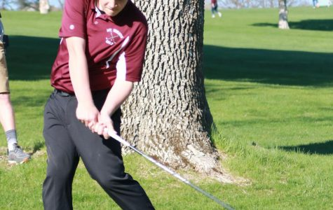 Freshman Steven Wolfe drives off the tee on hole seven at Kernoustie Golf Course.