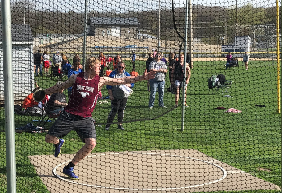 Senior+discus+Thrower+Matt+Vislisel+prepares+to+throw+the+discus+at+a+track+meet+in+Anamosa.+