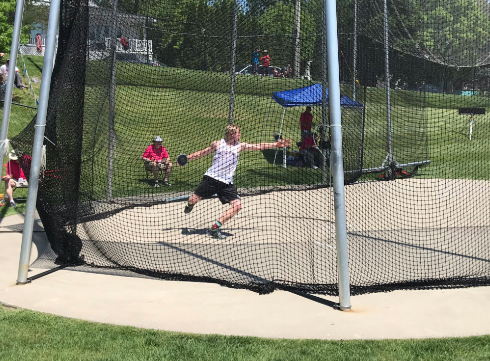 Senior Matt Vislisel winds up for his throw at state track. Vislisel won the class 3A state championship