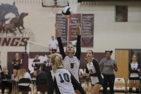 Freshman setter Kameron Brand sets the ball to her teammate during the freshman game against West Delaware on Sept. 5.
