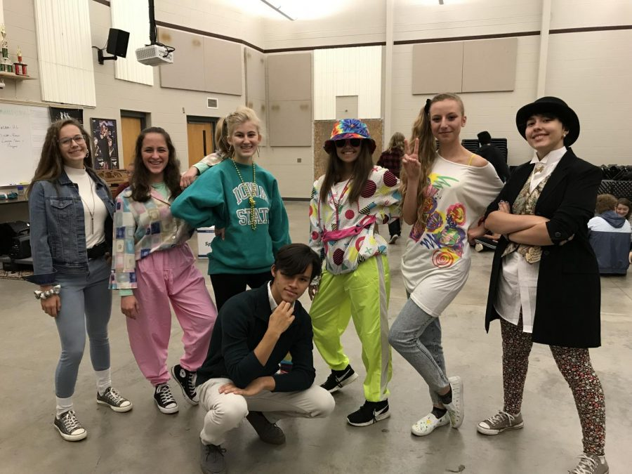 Bringing the 80s back, band kids show their school spirit by dressing up during homecoming week Sept. 26. Pictured are Claire Gaffney, Emrys Yamanishi, Megan Baumler, Matt Recalde, Reilly Gross, Bri Cooklin, and Lily Cripe.
