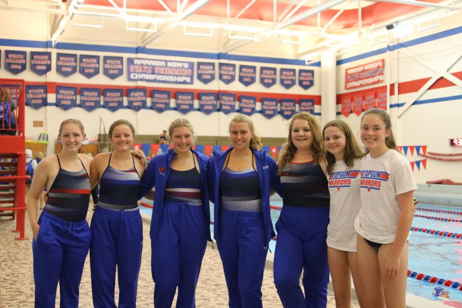 All+seven+MVHS+girls+pose+for+a+team+picture+at+Cedar+Rapids+Washington%27s+home+meet+against+Walhert+Catholic+Aug.+27.+Mount+Vernon+swimmers+and+divers+include+Audi+Eichhorn%2C+Lillie+Hawker%2C+Abby+Jones%2C+Sydney+Jones%2C+Michaela+Rowell%2C+Isabel+Hawker+and+Hedy+Zmolek.+Photo+by+Lily+Palmershiem.