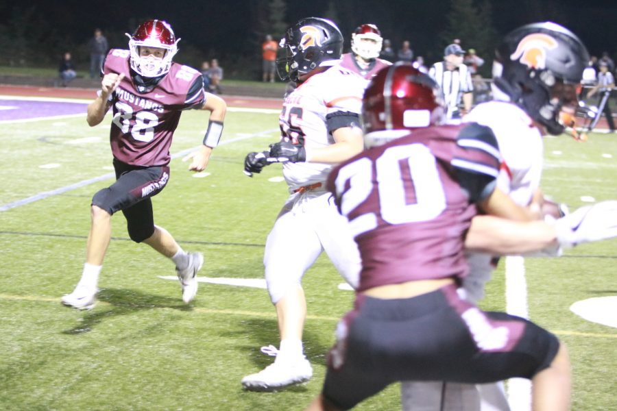 Senior Nolan Brand (88) looks for an opening Aug 30. The Mustangs lost to Solon 35-7.
