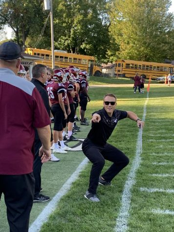 Coach Ben Knake celebrates after a touchdown