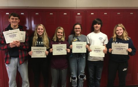 Student journalists hold their awards received for their contributions to the yearbook Oct. 31. The students pictured are (left to right) Aydan Holub-Schultz, Jorie Randall, Reagan Light, Lillie Hawker, Kai Yamanishi, and Lauren McCollum. Not pictured: Caroline Voss. Photo by JoAnn Gage
