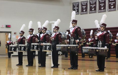 The Marching Mustangs' award winning drum line stands at attention during their indoor finale Oct . 24