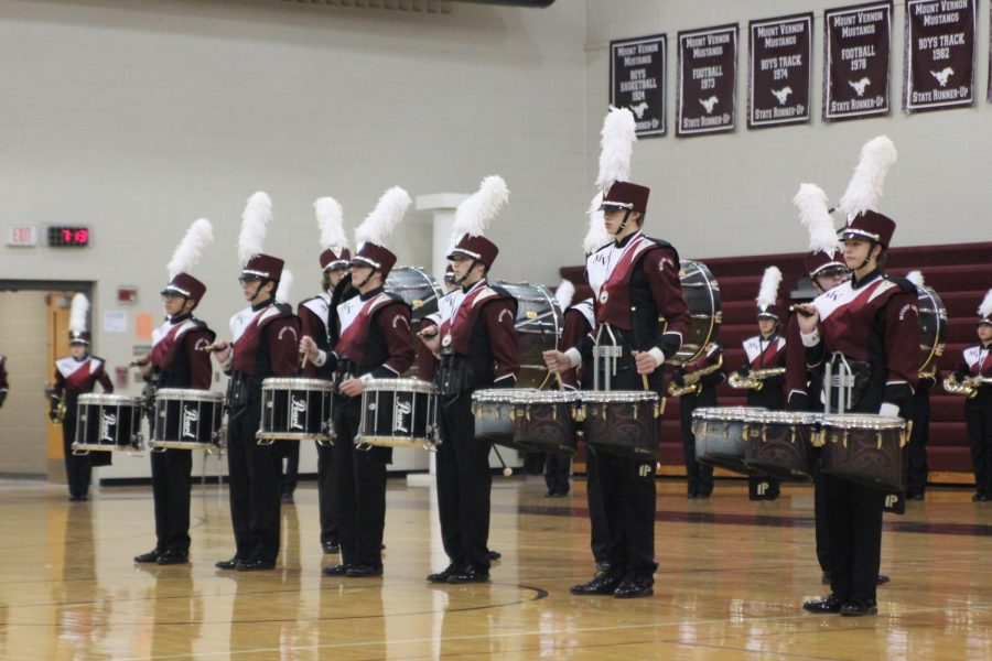 The+Marching+Mustangs%27+award+winning+drum+line+stands+at+attention+during+their+indoor+finale+Oct+.+24