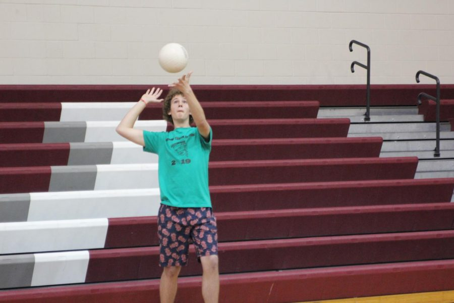 Sophomore Steven Wolfe serves to the seniors during their match.