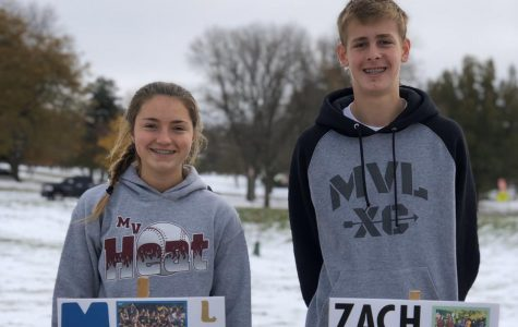 Laura Swart and Zach Fall pose with their state cross country signs.