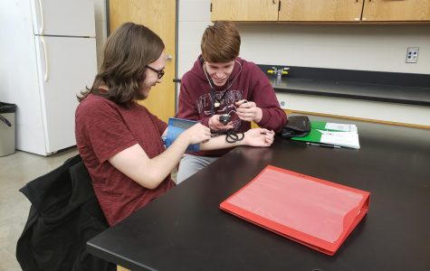 Vaun Remerouski and Tyler Stine take each others blood pressure in Exercise Science Jan. 10.
