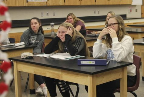 Ooh, gross! Junior Jorie Randall and sophomore Cami Streicher react to video of a shoulder being popped into place during exercise science J-term class.
