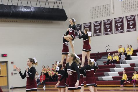 During the last varsity cheer performance sophomore Kambree Hultquist does an assited lib.