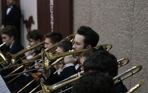 Eli Webster, junior, plays his trombone at Festival of Bands. Photo by Lillie Hawker.